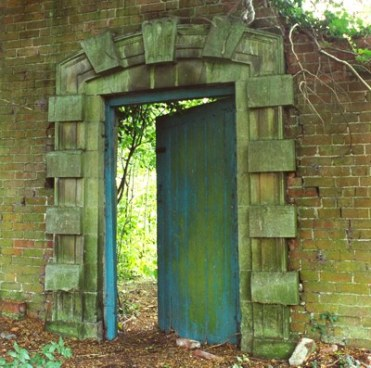 A secret door in a walled garden